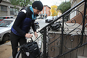 Brooklyn, N.Y. November 11, 2013.  Jose leaves her apartment for the daily commute to work in Manhattan on a chilly November morning. 11/11/2013. Photo by Erin Brodwin/NYCity Photo Wire
