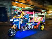 27 JANUARY 2016 - BANGKOK, THAILAND: A tuk-tuk (three wheeled taxi) on Soi Nana in front of 23 Bar and Gallery in the Chinatown neighborhood of Bangkok.       PHOTO BY JACK KURTZ