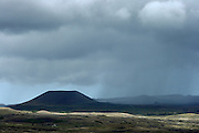 Rain falls in the distance in Easter Island, seen from the north-east coast