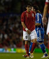 Photo: Daniel Hambury.<br />England v Greece. International Friendly. 16/08/2006.<br />England's Owen Hargreaves holds his vitals.
