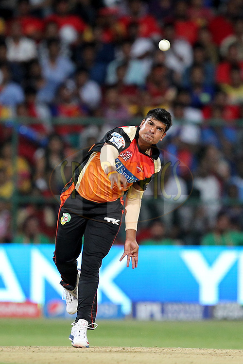 Karn Sharma of the Sunrisers Hyderabad bowls during match 24 of the Pepsi Indian Premier League Season 2014 between the Royal Challengers Bangalore and the Sunrisers Hyderabad held at the M. Chinnaswamy Stadium, Bangalore, India on the 4th May  2014Photo by Prashant Bhoot / IPL / SPORTZPICSImage use subject to terms and conditions which can be found here:  http://sportzpics.photoshelter.com/gallery/Pepsi-IPL-Image-terms-and-conditions/G00004VW1IVJ.gB0/C0000TScjhBM6ikg