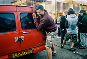 A man pushing a van, DJ Gordie's 71st Birthday Party, Iceland Road, Hackney Wick, London 2017
