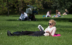 London Enjoys a Sunny and Warm Day. People rest and enjoy a clear, sunny and warm weather today with 18ºC degrees. Regent\'s Park, London, United Kingdom. Wednesday, 30th April 2014. Picture by Daniel Leal-Olivas / i-Images