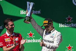 November 12, 2017 - Sao Paulo, Sao Paulo, Brazil - Nov, 2017 - Sao Paulo, Sao Paulo, Brazil - In the photo VALTTERI BOTTAS celebrates with the trophy of second place. German driver SEBASTIAN VETTEL/Scuderia Ferrari won the Brazilian Formula One Grand Prix on Sunday at the Interlagos autodromo in Sao Paulo. VALTTERI BOTTAS/Mercedes AMG was second place, followed by filipinos KIMI RAIKKONEN/Scuderia Ferrari. (Credit Image: © Marcelo Chello via ZUMA Wire)
