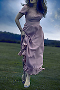 a woman in a pink dress is running on a meadow