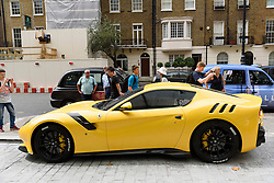 © Licensed to London News Pictures. 25/08/2016.  A fleet of supercars including a Ferrari F12TDF is parked in Knightsbridge.  The cars are believed to be owned by Quatar Sheikh Khalifa bin Hamad bin Khalifa Al-Thani otherwise know as KHK. London, UK. Photo credit: Ray Tang/LNP