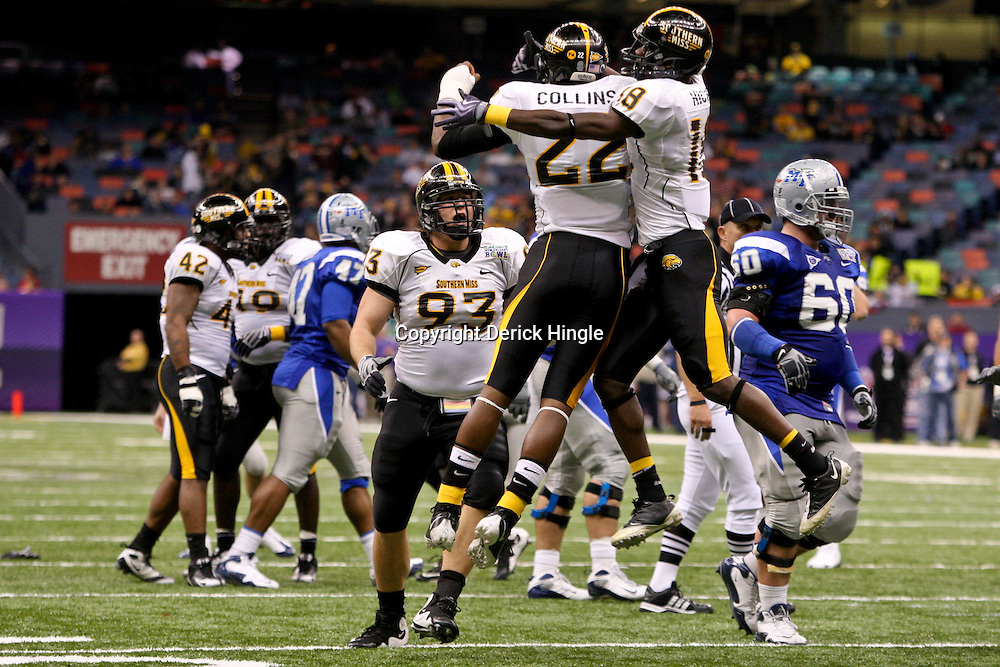 Dec 20, 2009; New Orleans, LA, USA; Southern Miss Golden Eagles cornerback Jamie Collins (22) and defensive back Eddie Hicks (18) celebrates after a blocked field goal against the Middle Tennessee State Blue Raiders during the first half of the 2009 New Orleans Bowl at the Louisiana Superdome.  Mandatory Credit: Derick E. Hingle-US PRESSWIRE