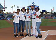 Jun 13, 2018; Los Angeles, CA, USA;  Los Angeles Dodgers center fielder Matt Kemp (27) poses with members of the NCAA champion Southern California Trojans women's 4 x 400m relay  before a MLB game against the Texas Rangers at Dodger Stadium. From left: Deanna Hill (3), Anna Cockrell (2), Kyra Constantine (1), Mep and  Kendall Ellis (4).