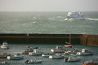 the arrival of the morning ferry from Belle Ile en Mer, into Quiberon, Brittany...photograph by Owen Franken for the NY Times..July 7, 2008..