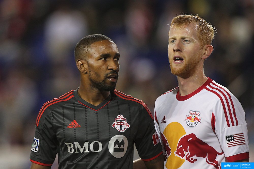 Jermain Defoe, Toronto FC, marked by Richard Eckersley, New York Red Bulls, during the New York Red Bulls Vs Toronto FC, Major League Soccer regular season match at Red Bull Arena, Harrison, New Jersey. USA. 11th October 2014. Photo Tim Clayton