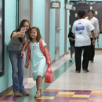 Andrea tackett and her daughter, Lilly Grace, 7, take a quick selfie before her first day of school at Lawhon Elementary School on Thursday.