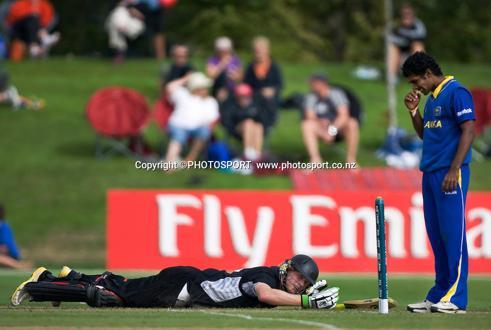 New Zealand batsman Harry Boam dives back into his ground after a run out attemp, Sri Lankan bowler Udara Jayasundara looks on. New Zealand v Sri Lanka, U19 Cricket World Cup group stage match, Village Green, QEII, Christchurch, Wednesday 20 January 2010. Photo : Joseph Johnson/PHOTOSPORT