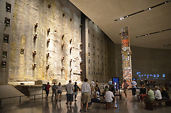 Sept. 4, 2014 - New York, New York, US - A group of visitors stands in front of the so-called 'Last Column' (R) at the 9/11 Museum in New York, USA, 4 September 2014. 'Last Column' was the last concrete-steel beam that was left during the cleanup of the rubble of the  twin towers of the former World Trade Centre which collapsed in the terrorist attacks on 9 September 2001. The column bears the dedication and pictures of the fire fighters and police officers who died in the attack.  The 9/11  Museum commemorates the around 3000 victims who died when the twin towers of the former World Trade Centre collapsed in the terrorist attacks. Photo:  Chris Melzer/dpa (Credit Image: © Chris Melzer/DPA/ZUMA Wire)
