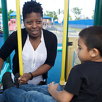 Supportive Housing program case worker, Melissa spends time at a Hartford playground with Joels, age 5. Melissa is Supportive Housing program case worker to Joel's mother Irma. Melissa has provided support to Irma for over two years. <br />