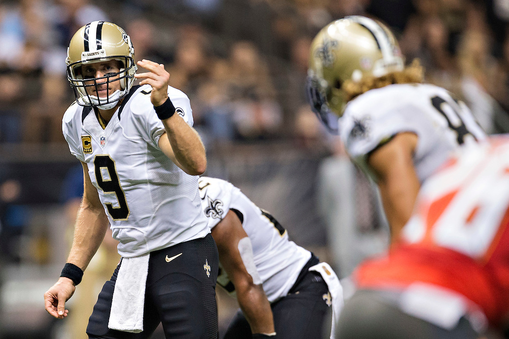 NEW ORLEANS, LA - SEPTEMBER 20:  Drew Brees #9 signals to Willie Snead #83 of the New Orleans Saints during a game against the Tampa Bay Buccaneers at Mercedes-Benz Superdome on September 20, 2015 in New Orleans Louisiana.  The Buccaneers defeated the Saints 26-19. (Photo by Wesley Hitt/Getty Images) *** Local Caption *** Drew Brees; Willie Snead
