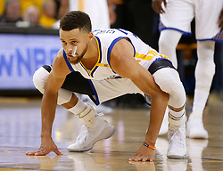 The Golden State Warriors' Stephen Curry stretches before taking some foul shots against the Cleveland Cavaliers in the second quarter of Game 5 of the NBA Finals at Oracle Arena in Oakland, Calif., on Monday, June 12, 2017. (Photo by Nhat V. Meyer/Bay Area News Group/TNS) *** Please Use Credit from Credit Field ***