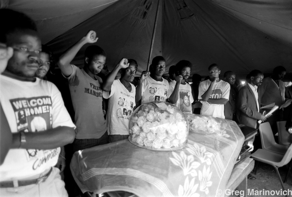 Anti Apartheid activists salute Wilson Matagu killed by police at his funeral in Khubvi village, 16 Feb, 1990. (Photo by Greg Marinovich)