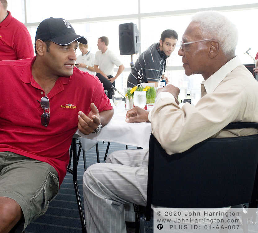 """Orestes Destrade (left), former New York Yankee and now co-host of XM Satellite Radio's MLB Home Plate radio program (left) talks with Buck O'Neil, (right) 94, during an XM Satellite Radio sponsored breakfast during All-Star Week 2006 in Pittsburgh, PA, July 11, 2006. John """"Buck"""" O'Neil was the oldest player to play a major league baseball game, and the first black coach in the majors, and is the goodwill ambassador for the Negro Leagues.<br />"""