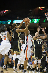 Virginia's Lyndra Littles (1) tries to grab the ball from Wake's Courteney Morris (5).  The Cavaliers defeated the Demon Deacon 77-71 on January 11, 2007 for their first ACC win in the John Paul Jones Arena in Charlottesville, VA.<br />