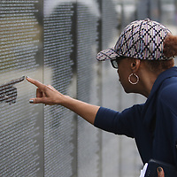 24 year Navey Veteran, Betty Townsend of Jackson, looks for the name of ther sister's fiance, who was killed in action on his first day of combat in Vietnam