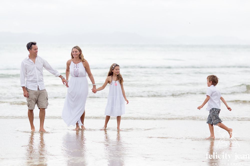low family photo shoot at kuaotunu on the coromandel peninsula photography by felicity jean photography beach family portraits a collection of family portrait photos taken on the Coromandel by Felicity Jean Photography authentic, candid & natural portrait images of families having fun