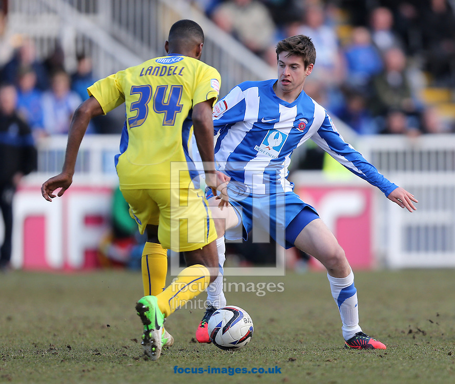 Picture by Paul Gaythorpe/Focus Images Ltd +447771 871632.06/04/2013.Ethan Ebanks-Landell of Bury and Greg Rutherford of Hartlepool United during the npower League 1 match at Victoria Park, Hartlepool.