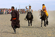 GOBI DESERT, MONGOLIA..08/26/2001.Bayangovi. Local Naadam festival. Finish of the runners-up in a horse race over 30 kilometers..(Photo by Heimo Aga).