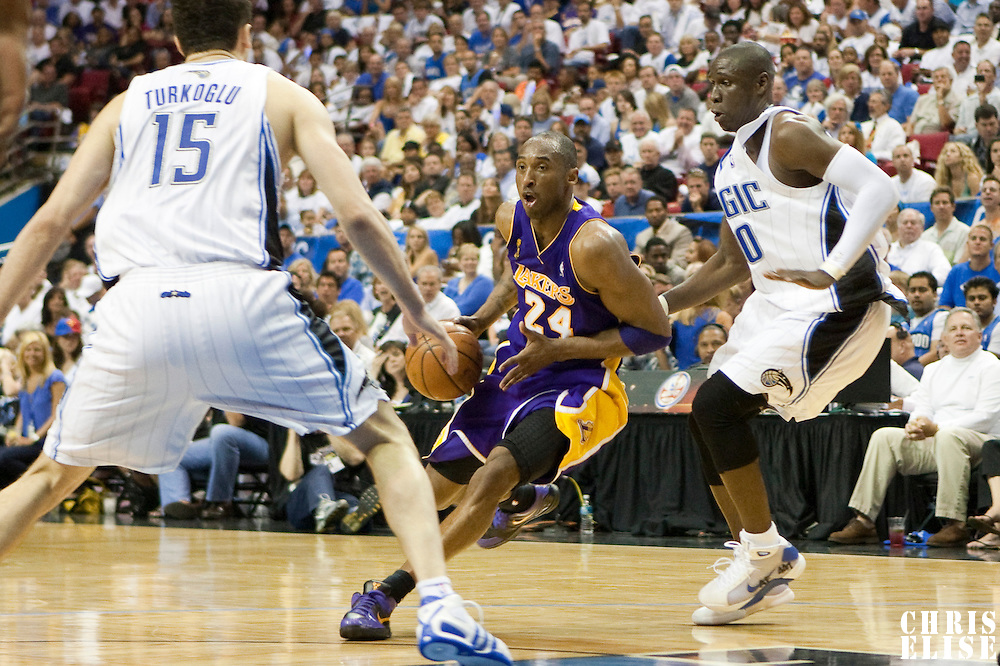 09 June 2009: Kobe Bryant of the Los Angeles Lakers dribbles past Mickael Pietrus of the Orlando Magic during game 3 of the 2009 NBA Finals won 108-104 by the Orlando Magic over the Los Angeles Lakers at Amway Arena, in Orlando, Florida, USA.