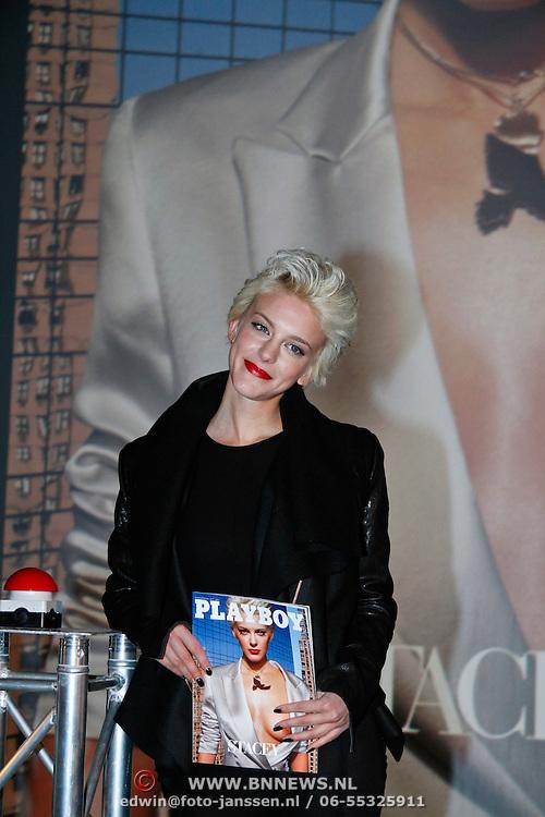 NLD/Amsterdam/20111207- Onthuling Playboy Stacey Rookhuizen, Stacey Rookhuizen met haar nummer van de Playboy