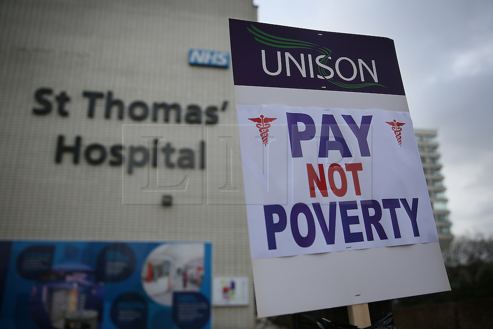 © Licensed to London News Pictures. 09/01/2016. London, UK.  A placard is placed near St Thomas' hospital during a rally against the proposed cancellation of bursaries for nurses hoping to train for work in the NHS.  Photo credit: Peter Macdiarmid/LNP