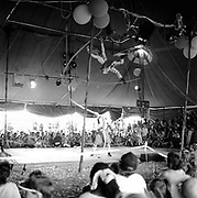 Crowd watching circus act inside tent, Glastonbury, Somerset, 1989