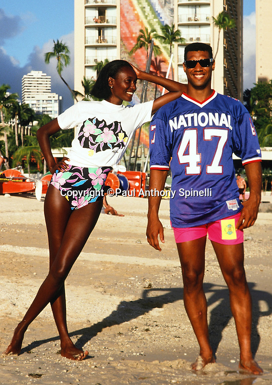 The National Football Conference Minnesota Vikings safety Joey Browner (47) poses for a photo with his wife on Waikiki Beach after photo day the week before the 1989 NFL Pro Bowl football game against the American Football Conference on Jan. 24, 1989 in Honolulu. The NFC won the game 34-3. (©Paul Anthony Spinelli)