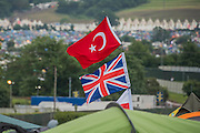 The Turkish flag flies above the Union Jack tomark a tent - or as a symbol of teh future post referendum? The 2016 Glastonbury Festival, Worthy Farm, Glastonbury.