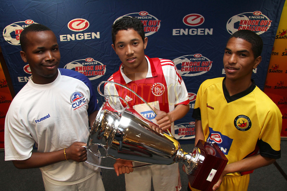 Fezile Hlangana captain of Chippa United, Ziyaad Eksteen captain of Ajax Cape Town and Wayde Williams captain of Santos with the Engen Knock Out Challenge Trophy during the Engen Knockout Challenge Media Conference held at Athlone Stadium in Cape Town on the 13th September 2012..Photo by Shaun Roy/ SPORTZPICS..