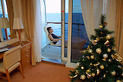 The MS Europa enters the delta of the Amazonas, visible because of the sediment-rich waters already 500 kilometers off the coast. Nicole Schmidt relaxing on her balcony while the Christmas tree is a strange and lonely reminder to the outside world.