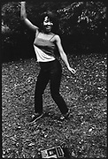 Woman dancing next to her boom box in Central Park New York, USA, 1980