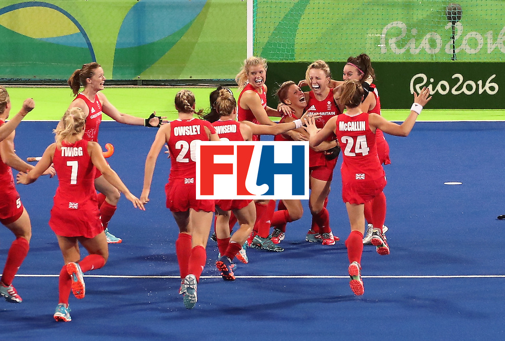 RIO DE JANEIRO, BRAZIL - AUGUST 19:  Hollie Webb #20 of Great Britain celebrates with teammates after scoring the game-winning penalty goal against the Netherlands during the Women's Gold Medal Match on Day 14 of the Rio 2016 Olympic Games at the Olympic Hockey Centre on August 19, 2016 in Rio de Janeiro, Brazil.  (Photo by Mark Kolbe/Getty Images)