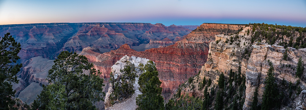 Dusk twilight at Mather Point Overlook, Grand Canyon National Park, Arizona, USA. Starting at least 5 to 17 million years ago, erosion by the Colorado River has exposed a column of distinctive rock layers, which date back nearly two billion years at the base of Grand Canyon. While the Colorado Plateau was uplifted by tectonic forces, the Colorado River and tributaries carved Grand Canyon over a mile deep (6000 feet), 277 miles  long and up to 18 miles wide. This image was stitched from multiple overlapping photos.
