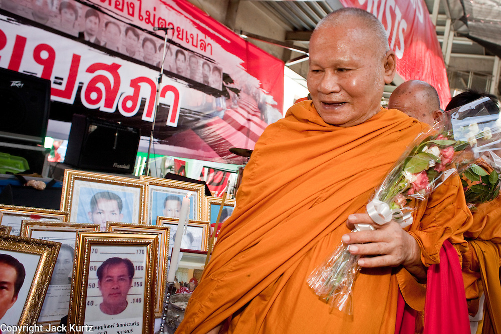 "10 MAY 2010 - BANGKOK, THAILAND: Buddhist monks leave the stage after a memorial service for the people killed in street violence in Bangkok on April 10. The Red Shirts held a special memorial service at their main protest site in Ratchaprasong Intersection Monday with Buddhist monks leading chants to mark the one month anniversary of the street violence on April 10 that left 25 dead and more than 800 injured. Thai media is reporting that Prime Minister Abhisit Vejjajiva has given the Red Shirts has given the Red Shirts until the end of today to either accept his ""Road Map for Reconciliation"" and end the protest or face unspecified consequences widely thought to include a military crackdown.   Photo by Jack Kurtz / ZUMA Press"
