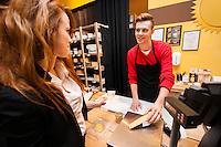 Female customer buying cheese at store