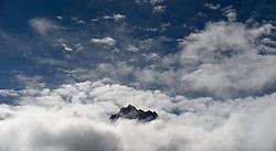 THEMENBILD - Trekkingtour in Nepal um die Annapurna Gebirgskette im Himalaya Gebirge. Das Bild wurde im Zuge einer 210 Kilometer langen Wanderung im Annapurna Gebiet zwischen 01. September 2012 und 15. September 2012 aufgenommen. im Bild ein unbekannter Gipfel des Himalaya ragt aus den Wolken // THEME IMAGE FEATURE - Trekking in Nepal around Annapurna massif at himalaya mountain range. The image was taken between september 1. 2012 and september 15. 2012. Picture shows unknown himalayan peak in the clouds, NEP, EXPA Pictures © 2012, PhotoCredit: EXPA/ M. Gruber