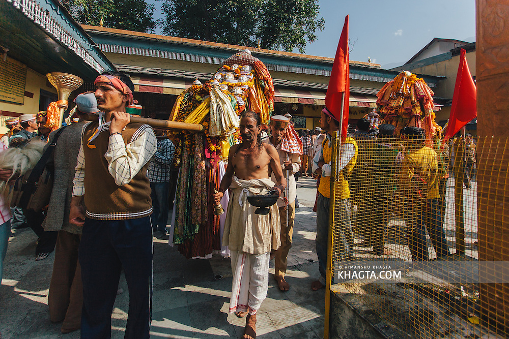 A Deity with his oracle moves out of Raghunath temple after taking his blessings on Kullu Dusshera. Kullu Dussehra is the Dussehra festival observed in the month of October in Himachal Pradesh state in northern India. It is celebrated in the Dhalpur maidan in the Kullu valley. Dussehra at Kullu commences on the tenth day of the rising moon, i.e. on 'Vijay Dashmi' day itself and continues for seven days. Its history dates back to the 17th century when local King Jagat Singh installed an idol of Raghunath on his throne as a mark of penance. After this, god Raghunath was declared as the ruling deity of the Valley.