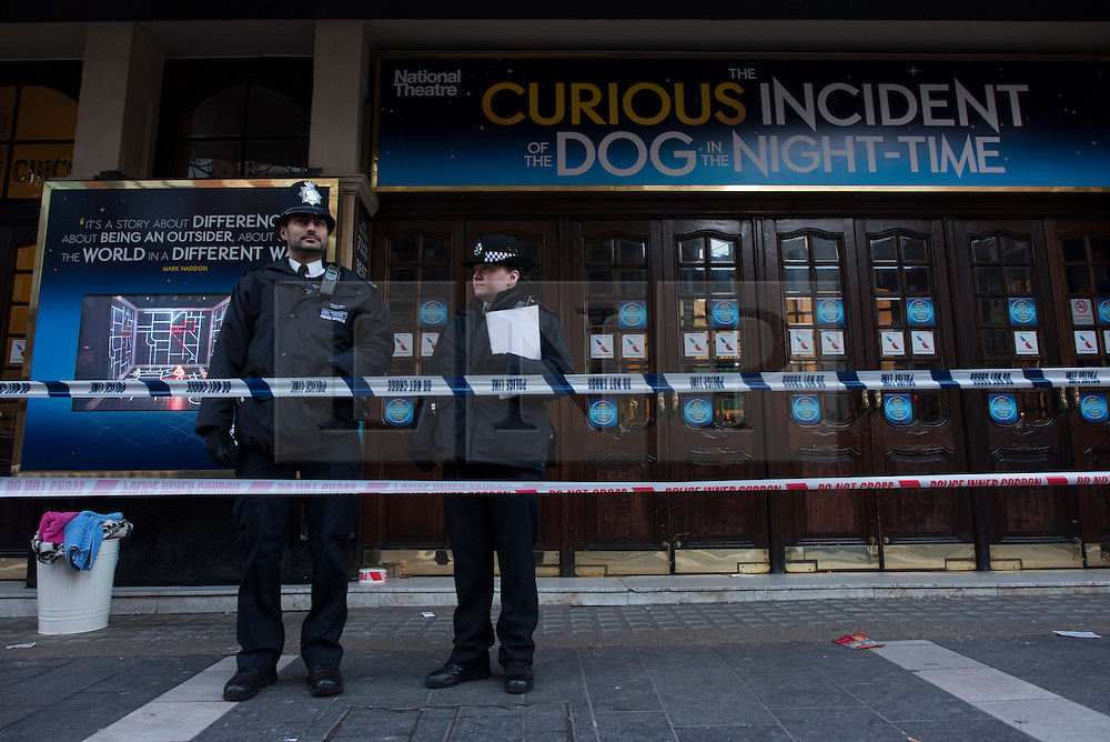 © Licensed to London News Pictures.20/11/2013. London, UK. Police officers at the Apollo Theatre. Seventy-six people injured, seven seriously hurt after the roof of the Apollo collapsed yesterday, on the 19th of December.Photo credit : Peter Kollanyi/LNP
