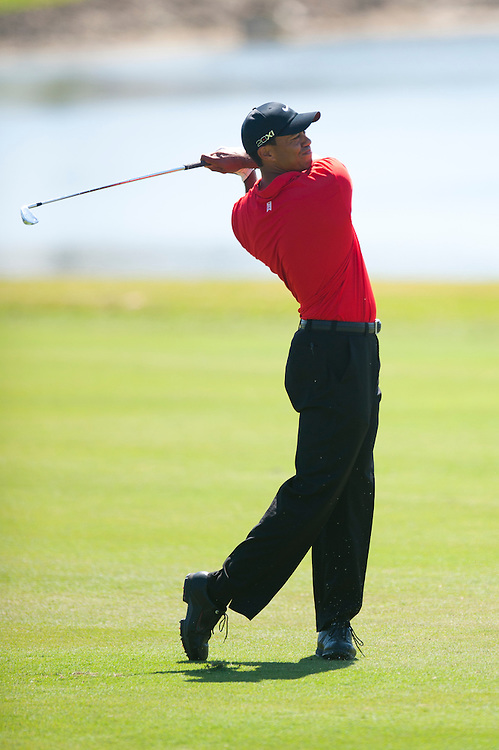 DORAL, FL - MARCH 13: Tiger Woods hits a shot from the fairway during the final round at the WGC-Cadillac Championship at the TPC Blue Monster at the Doral Golf Resort and Spa on March 13, 2011 in Doral, Florida. (Photo by Rob Tringali)  *** Local Caption *** Tiger Woods