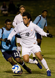 Virginia midfielder Jonathan Villanueva (10) dribbles around St. Peters midfielder Braulio Constantino (13).  The Virginia Cavaliers defeated the Saint Peters Peacocks 3-1 in the first round of the NCAA Men's Soccer tournament held at Klockner Stadium in Charlottesville, VA on November 24, 2007.