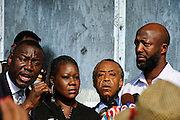 Matt Roth/Novus Select.Thursday, March 22, 2012..Members of the press and rally-goers photograph Benjamin Crump, Trayvon Martin's parents' attorney, who, along with Rev. Al Sharpton, announce that the Sanford Chief of Police Bill Lee has temporarily stepped down before the official start of a rally at Fort Mellon Park in Sanford, Florida Thursday, March 22, 2012 addressing 17-year-old Trayvon Martin's killing. Trayvon Martin's mother Sybrina Fulton, stands to the left of Sharpton, and  Tracy Martin, right, the father of Trayvon Martin, stands on the right...Rev. Al Sharpton spoke at the rally for slain black teen Trayvon Martin at Fort Mellon Park in Sanford, Florida Thursday, March 22, 2012. Trayvon Martin, 17, who was unarmed, carrying only a bag of Skittles and iced tea, was shot after an altercation by neighborhood watch volunteer George Zimmerman, 28, who pursued Trayvon on foot after being told not to by 911 dispatchers. Zimmerman has yet to be arrested because of Florida's controversial Stand Your Ground Law.