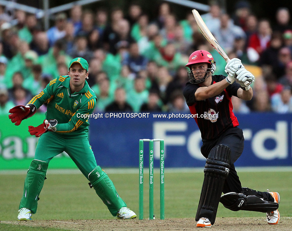Matt Henry batting for Canterbury, with South African wicket keeper AB de Villiers. Canterbury Wizards v South Africa. International Twenty20 cricket match, Hagley Oval, Wednesday 15 February 2012. Photo : Joseph Johnson / photosport.co.nz