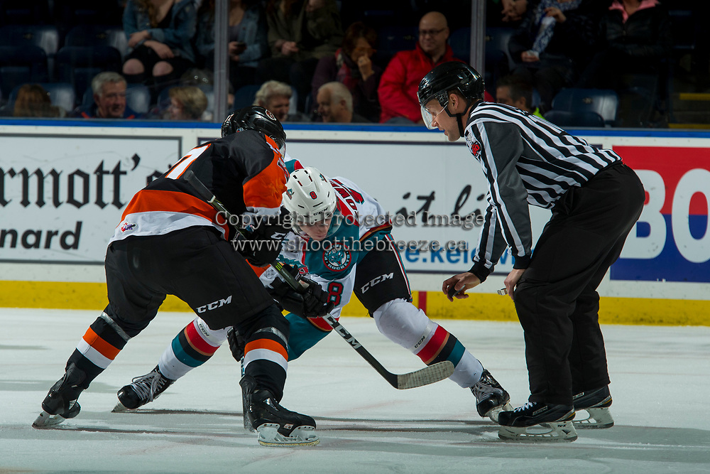 KELOWNA, CANADA - JANUARY 30: Linesman Dustin Minty prepares to drop the puck between Jack Cowell #8 of the Kelowna Rockets and Gary Haden #17 of the Medicine Hat Tigers on January 30, 2017 at Prospera Place in Kelowna, British Columbia, Canada.  (Photo by Marissa Baecker/Shoot the Breeze)  *** Local Caption ***