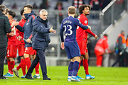 Tottenham Hotspur Manager José Mourinho goes to shake hands with Tottenham Hotspur midfielder Christian Eriksen (23) during the Champions League match between Bayern Munich and Tottenham Hotspur at Allianz Arena, Munich, Germany on 11 December 2019.