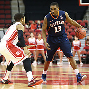Tracy Abrams #13 of the Illinois Fighting Illini tries to get past Maurice Watson Jr. #1 of the Boston University Terriers during the NIT First Round game at Agganis Arena on March 19, 2014 in Boston, Massachusetts . (Photo by Elan Kawesch)